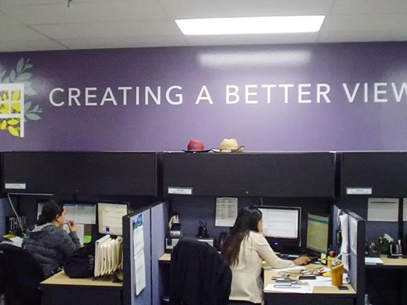 Custom wall decal displaying company logo and message
